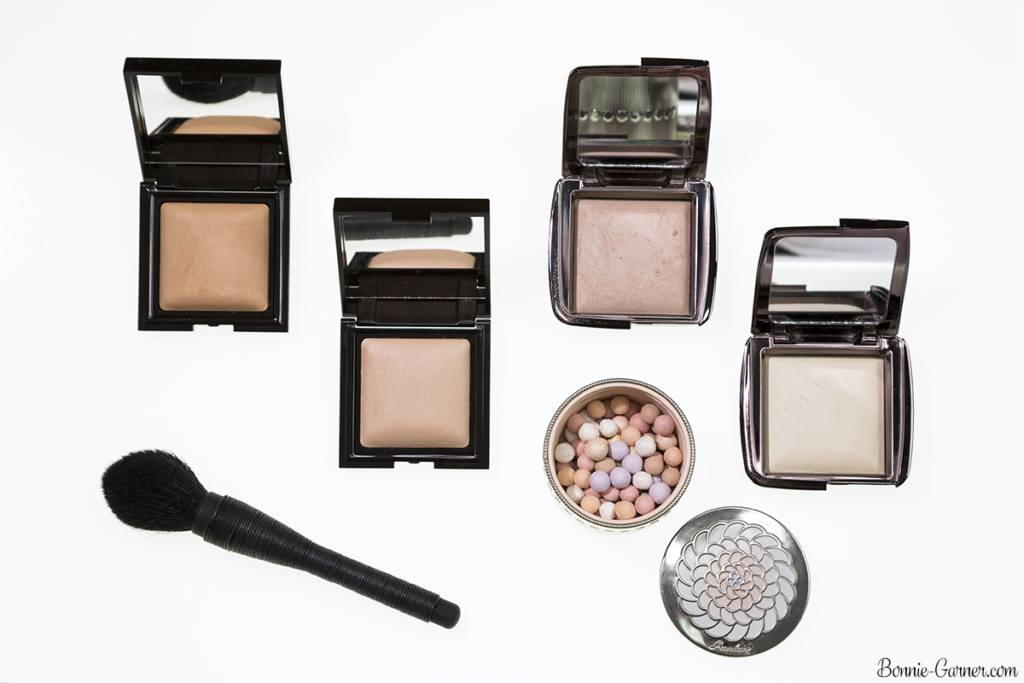 Laura Mercier Candleglow Sheer Perfecting Powder: 01 Fair, 02 Light; Hourglass Ambient Lighting Powder: Diffused Light, Dim Light; Guerlain Les Météorites 02