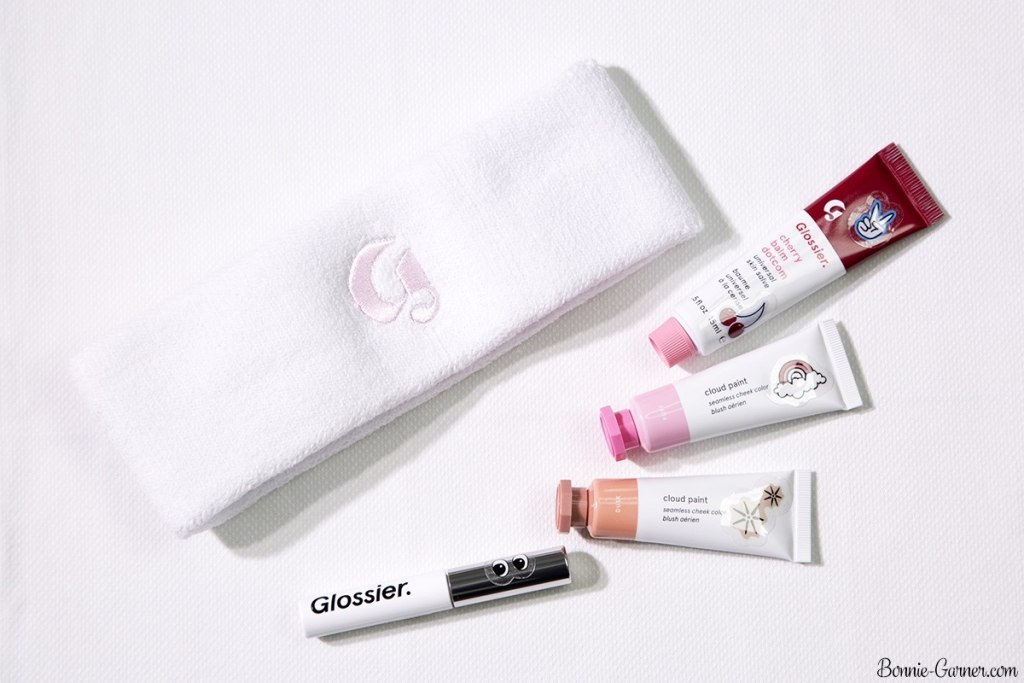Glossier: headband, Cloud Paint Dusk, Puff; Balm Dotcom Cherry; Boy Brow Brown